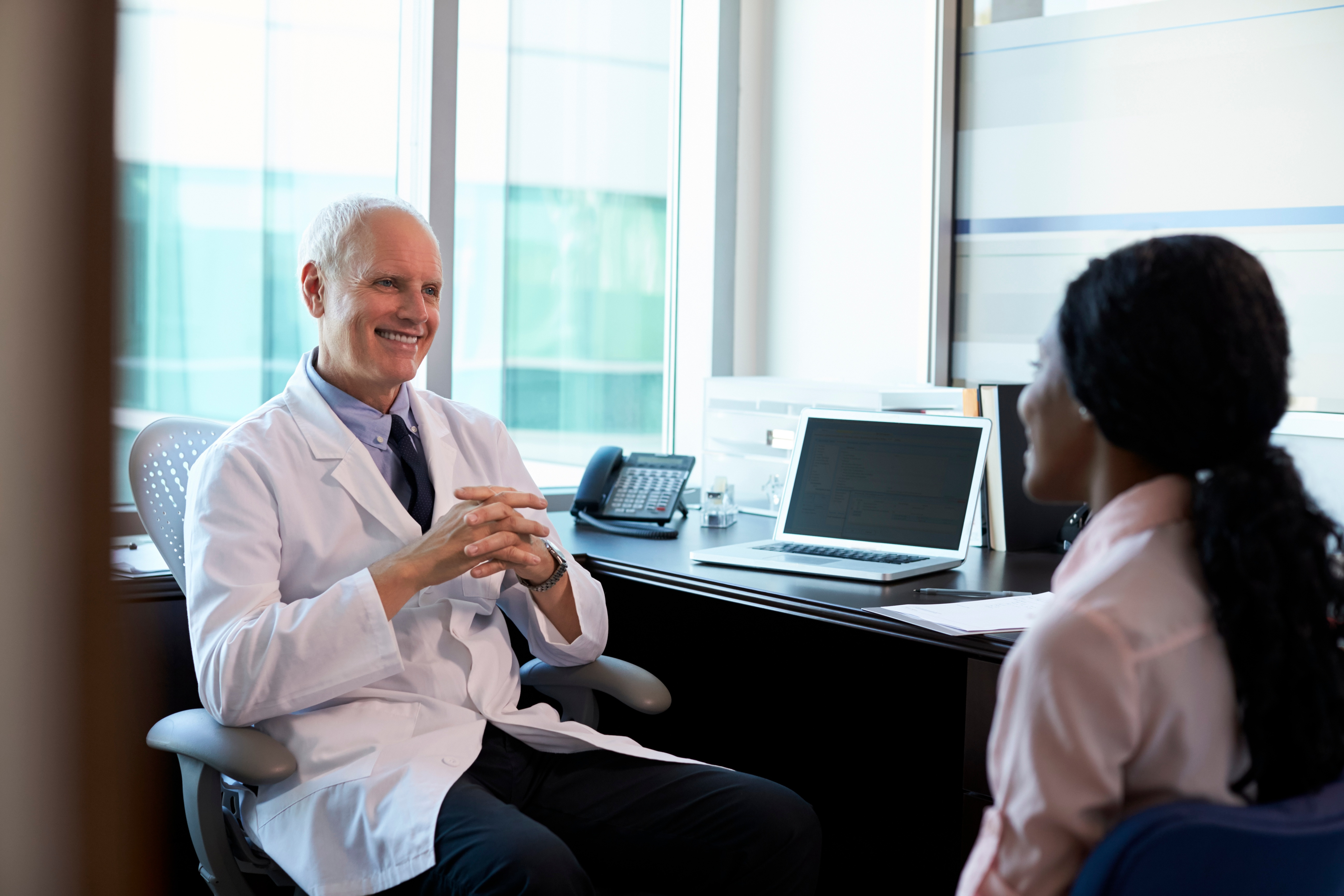 doctor-in-consultation-with-female-patient-PLZRUWN
